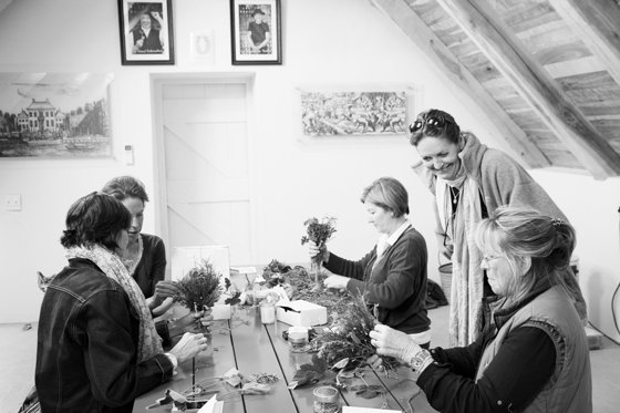Ladies binding herbs together at the Herb Workshop at Babylonstoren in 2014