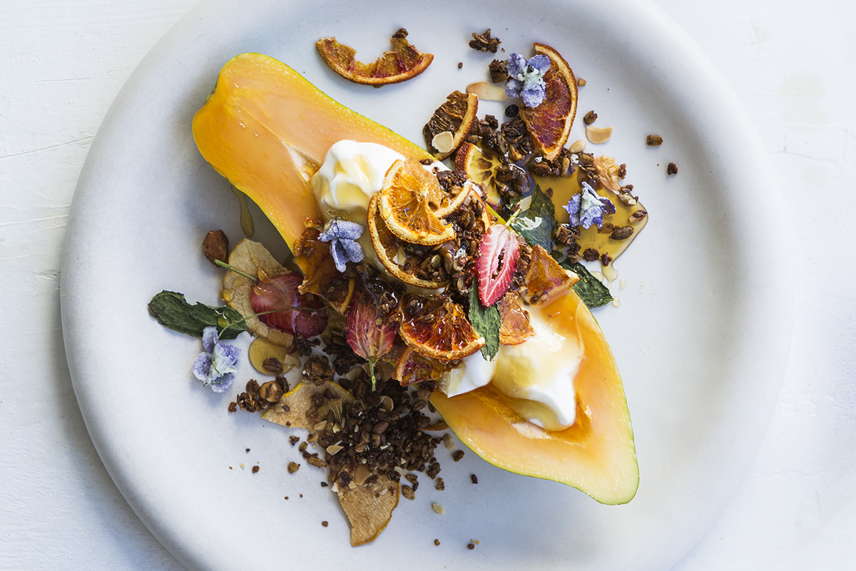 RECIPE: Honey granola with fruit crisps and dried mint leaves